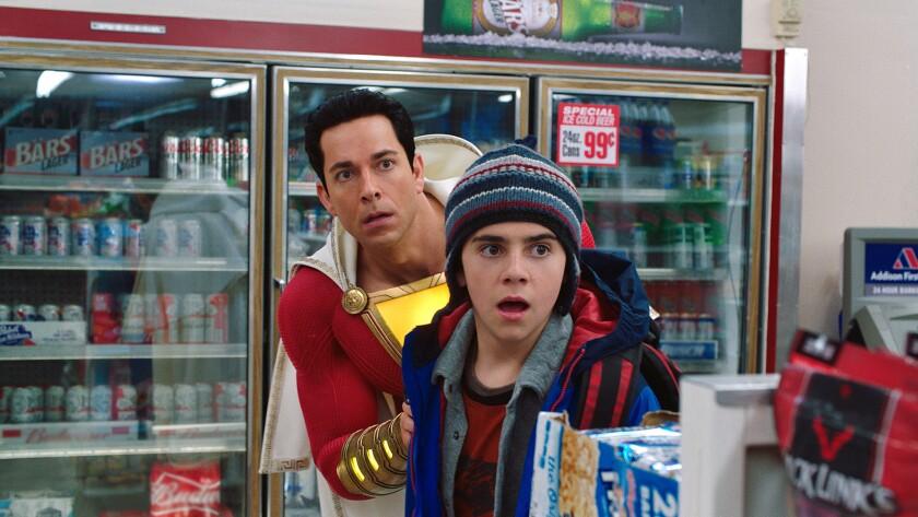 (L-r) ZACHARY LEVI as Shazam and JACK DYLAN GRAZER as Freddy Freeman in New Line Cinema?s action adv