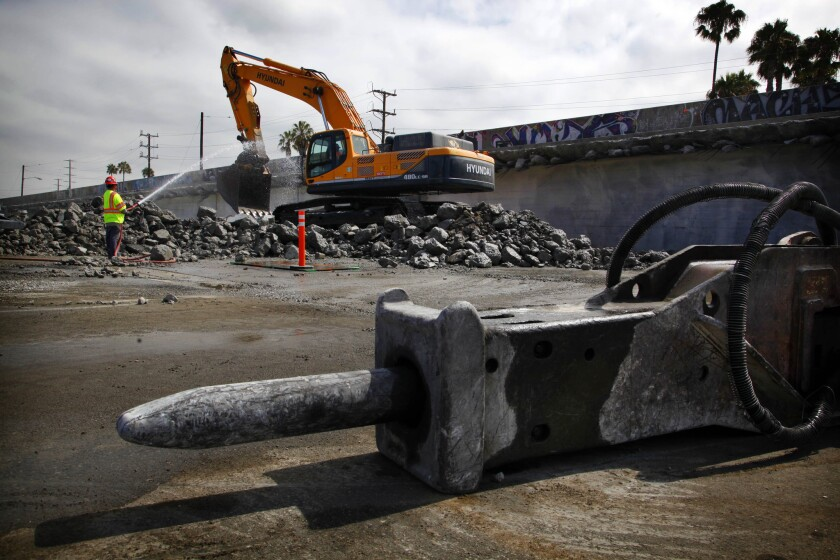 Construction workers will finish demolishing a bridge on Century Boulevard this weekend. The work will be done during a planned 57-hour closure near the entrance to LAX.