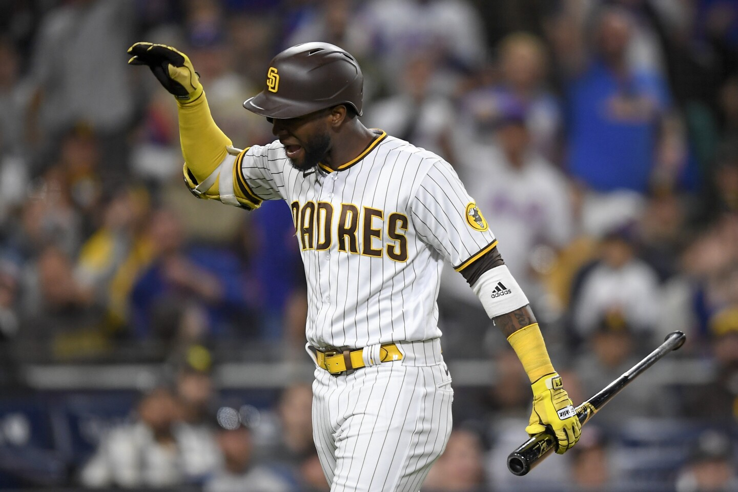 SAN DIEGO, CA - JUNE 5: Jurickson Profar #10 of the San Diego Padres reacts after being ejected during the eighth inning of a baseball game against New York Mets at Petco Park on June 5, 2021 in San Diego, California. (Photo by Denis Poroy/Getty Images)