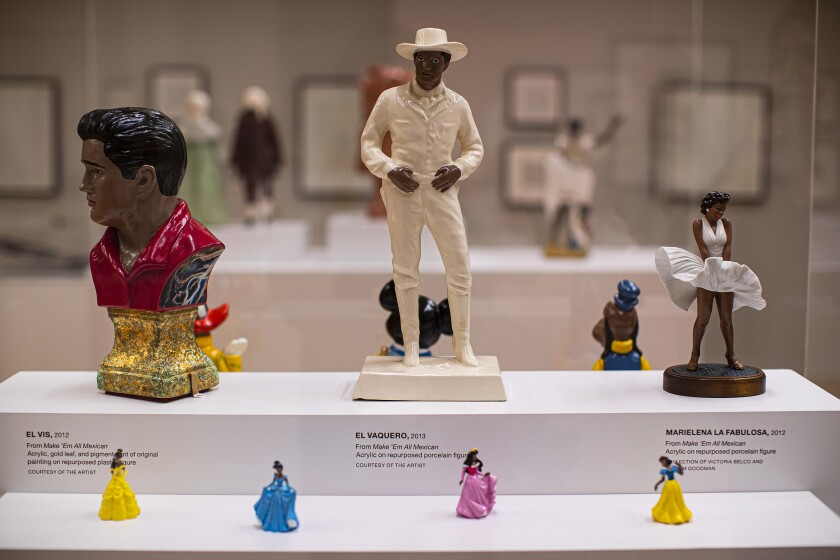 LOS ANGELES, CA - JUNE 5, 2019: Acrylic on repurposed porcelain figures called Make 'Em All Mexican
