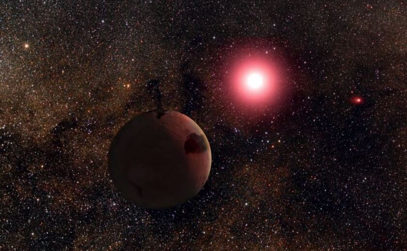 An artist's rendering of a newly discovered frozen planet orbiting one star of a binary star system 3,000 light-years from Earth.