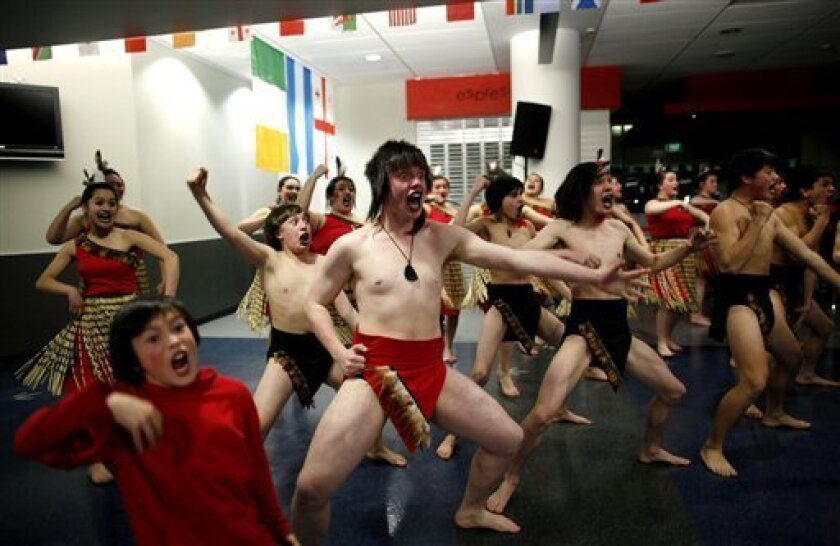 A group performs the Haka, a traditional Maori dance, before welcoming ceremony for Argentine rugby team at Dunedin's airport, New Zealand, Thursday, Sept. 1, 2011 ahead of the upcoming Rugby World Cup. Argentina will play their opening Pool B match against England in Dunedin on Sept. 10. (AP Photo/Natacha Pisarenko)