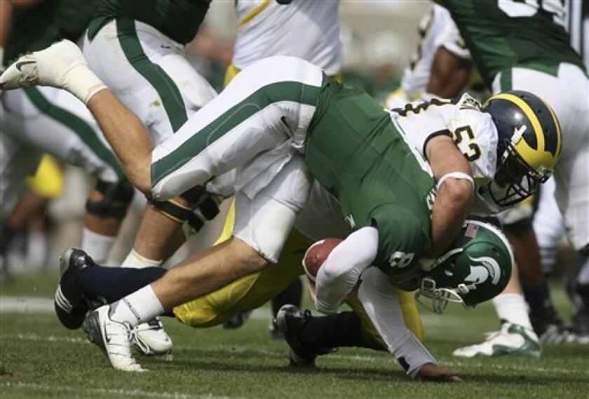 Michigan's Ryan Van Bergen (53) sacks Michigan State quarterback Kirk Cousins during the second quarter of an NCAA college football game, Saturday, Oct. 3, 2009, in East Lansing, Mich. (AP Photo/Al Goldis)