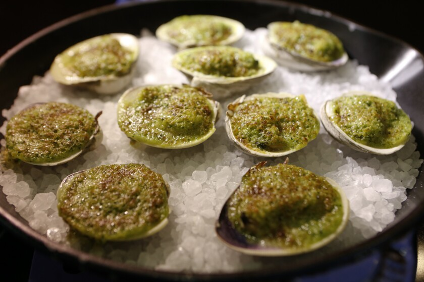 Clams prepared by Chef Michael Cimarusti (CQ) from Providence and Connie and Ted's restaurant. Recipe: Broiled clams with herbed butter