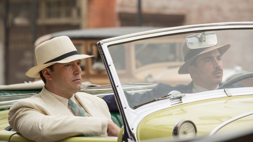 """Ben Affleck, left, and Chris Messina in the movie """"Live By Night."""""""