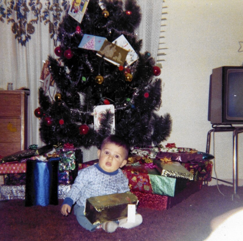 In a common tradition for many Latino families, Hector Becerra, shown in 1972 as a 6-month-old infant, and his family celebrated Christmas a day early.