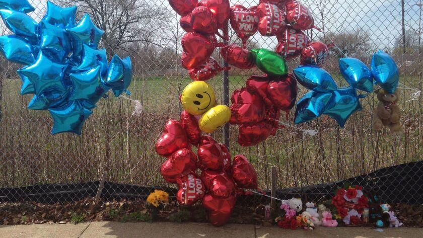 A makeshift memorial sits along a fence near where Robert Godwin Sr. was killed in Cleveland.