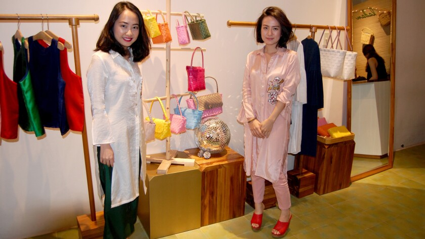 Thao Dao and Anna Phan returned from college in the U.S. to open Ladan, a company that sells modern Vietnamese clothes and accessories to young people. (L.R. Meyers)