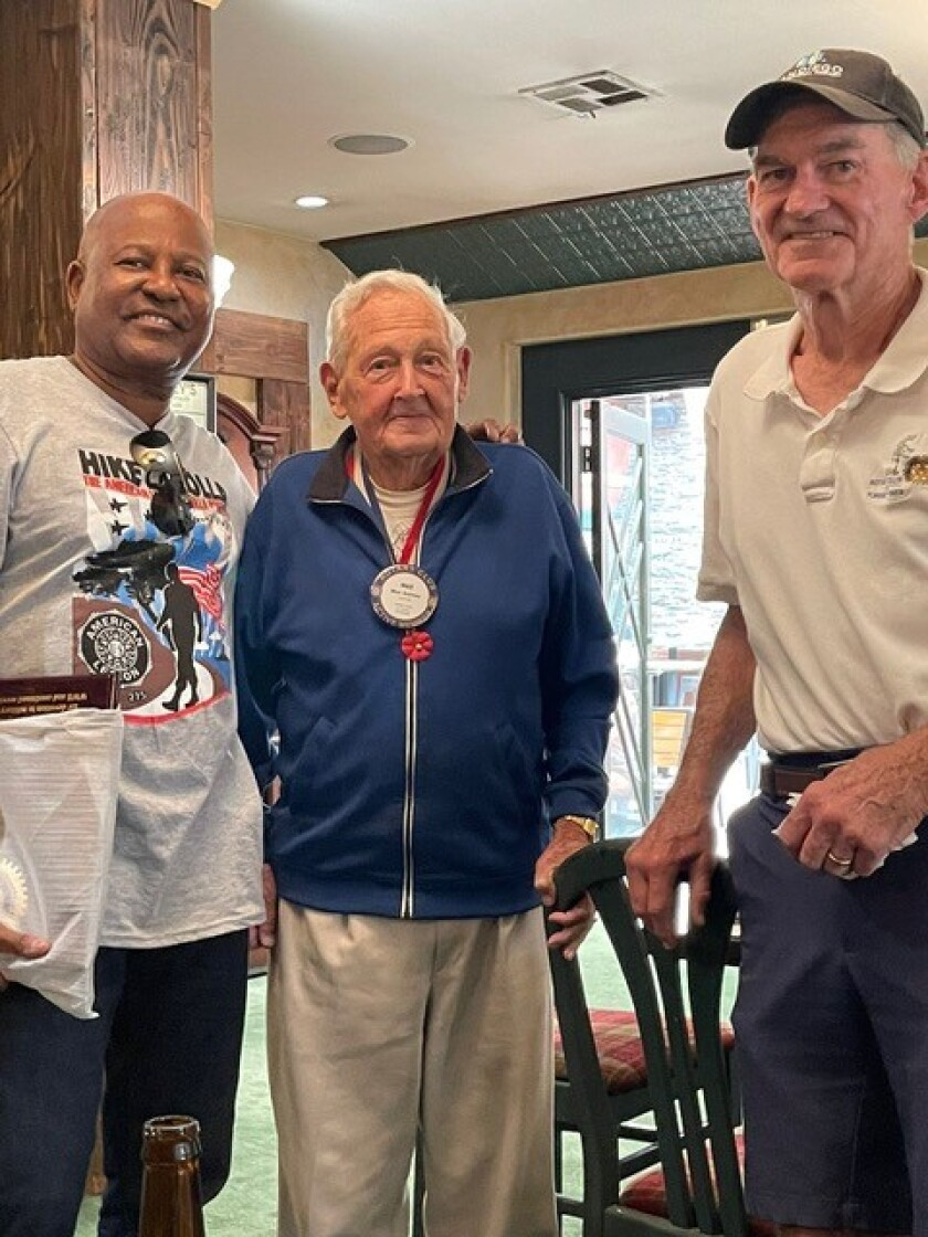 Max Gurney (center) stands with American Legion Post 275 Commander Jose Payne King and Rotarian Bill Irwin.