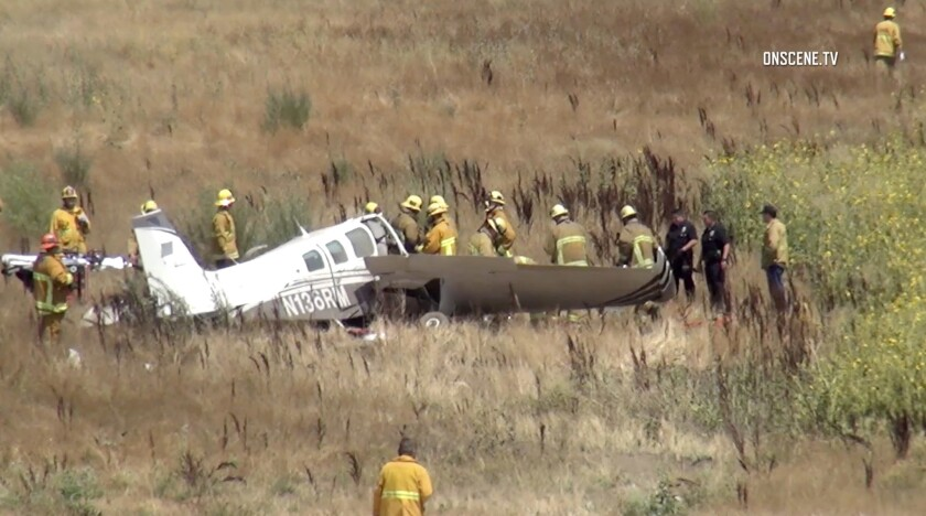 Emergency personnel at the scene of a plane crash Sunday in Sylmar.