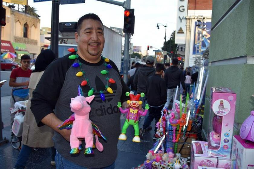 Photo taken Dec. 23, 2018, showing a street vendor selling toys in Hollywood, California. Starting on Jan. 1, 2019, California will make street vending legal, creating a boon for many small businesspeople, the vast majority of them Hispanics. EFE-EPA/Ivan Mejia