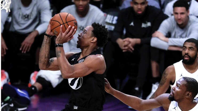 LOS ANGELES, CA, SUNDAY, FEBRUARY 18, 2018 -- DeMare DeRozan of Team Steph gets by Kevin Durant of T