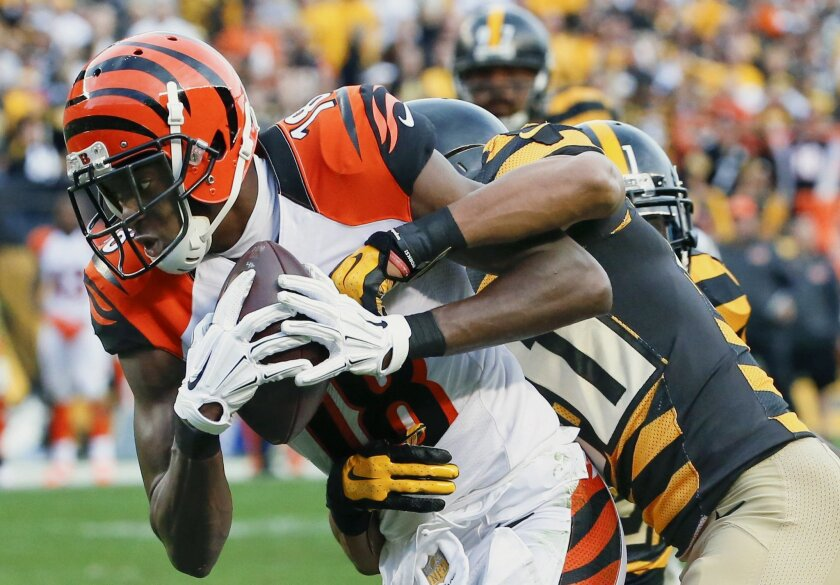 Cincinnati Bengals wide receiver A.J. Green (18) makes a catch and takes it in for a touchdown as Pittsburgh Steelers defensive back Ross Cockrell (31) defends in the second half of an NFL football game, Sunday, Nov. 1, 2015 in Pittsburgh. The Bengals won 16-10. (AP Photo/Gene J. Puskar)