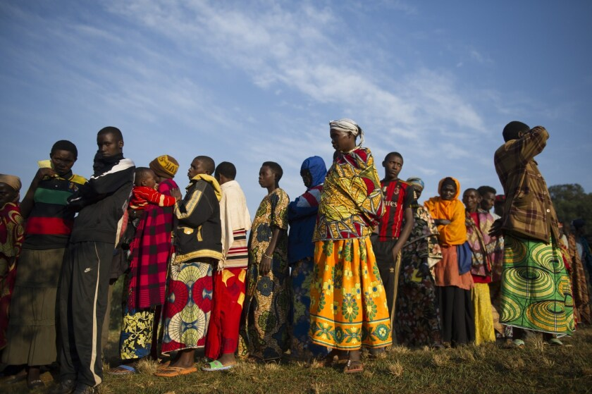 Residents line up prior to casting their vote in the village of Buye, Burundi, on July 21, 2015.