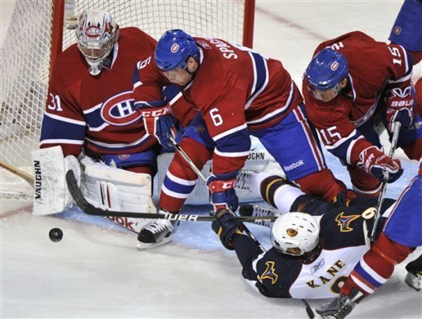 Atlanta Thrashers left wing Evander Kane manages to get the puck past Montreal Canadiens goalie Carey Price for a goal as Canadiens defenseman Jaroslav Spacek (6) and Jeff Halpern (15) look on during the second period of an NHL hockey game Sunday, Jan. 2, 2011, in Montreal. (AP Photo/The Canadian Press, Paul Chiasson)