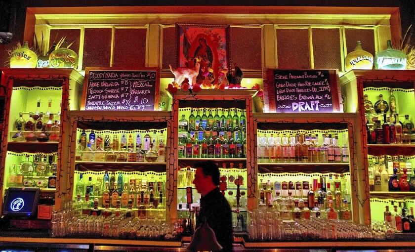 Bar manager Raul Yrastorza has dozens of mezcals at his fingertips at Las Perlas in downtown L.A.