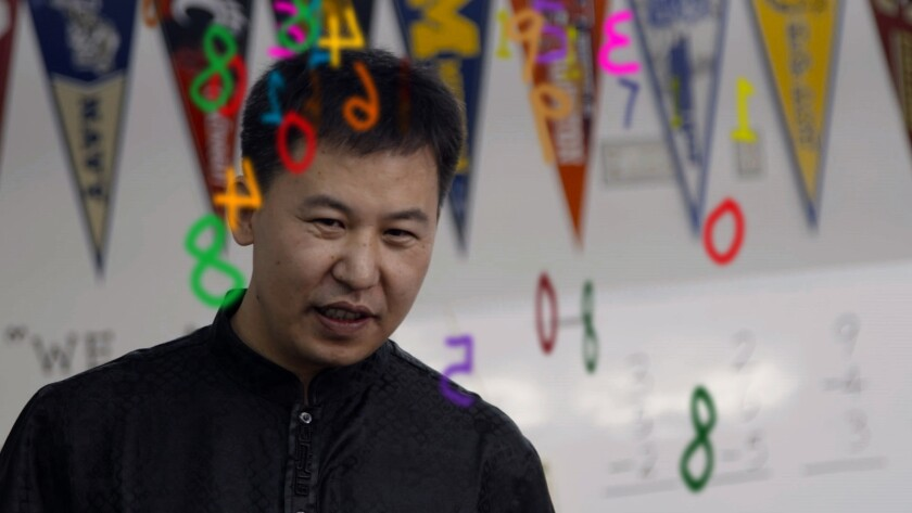 """Li Mianjun teaching children with a learning technique called abacus in a scene from the movie """"Bett"""