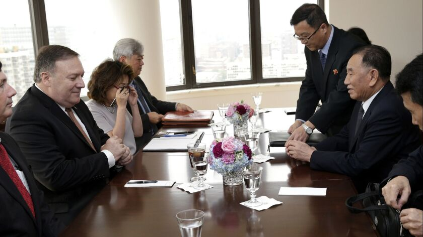 Kim Yong Chol, right, former North Korean military intelligence chief and one of leader Kim Jong Un's closest aides, sits across from U.S. Secretary of State Mike Pompeo during a meeting on May 31 in New York.