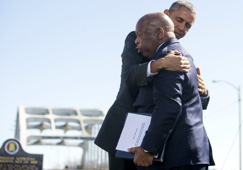 President Obama hugs U.S. Rep. John Lewis (D-Ga.), one of the original 1965 marchers in Selma, at an event marking the 50th anniversary of what became known as Bloody Sunday.