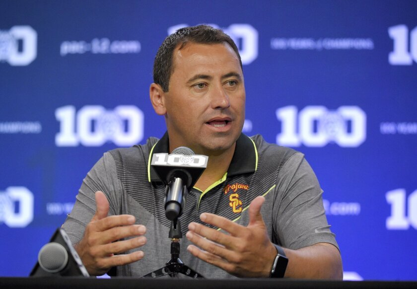 USC Coach Steve Sarkisian speaks to reporters Friday as part of Pac-12 football media days in Burbank.