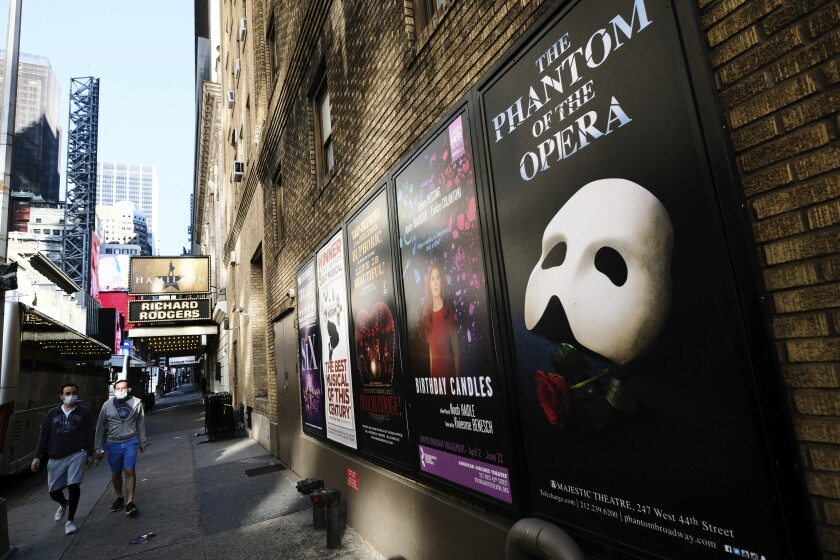 """FILE - Broadway posters outside the Richard Rodgers Theatre in New York on May 13, 2020. Broadway theaters may be dark but there will be plenty of new online productions of some of classic plays this fall. """"Hamilton"""" producer Jeffrey Richards on Wednesday unveiled a seven weekly play run of livestreamed works to benefit The Actors Fund. They will stream on Broadway's Best Shows and ticket buyers can access the events through TodayTix starting at $5. The plays include """"The Best Man,"""" """"This Is Our Youth,"""" Time Stands Still"""" and """"Race"""" (Photo by Evan Agostini/Invision/AP, File)"""