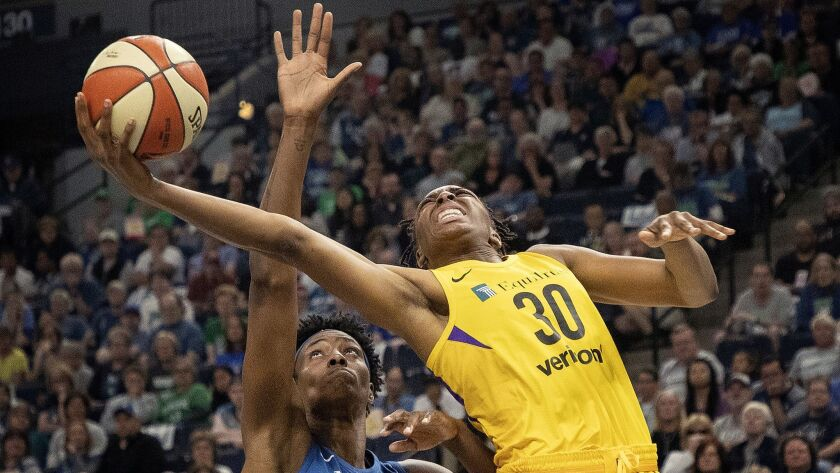 Sylvia Fowles, left, of the Minnesota Lynx defends Nneka Ogwumike, right, of the Los Angeles Sparks
