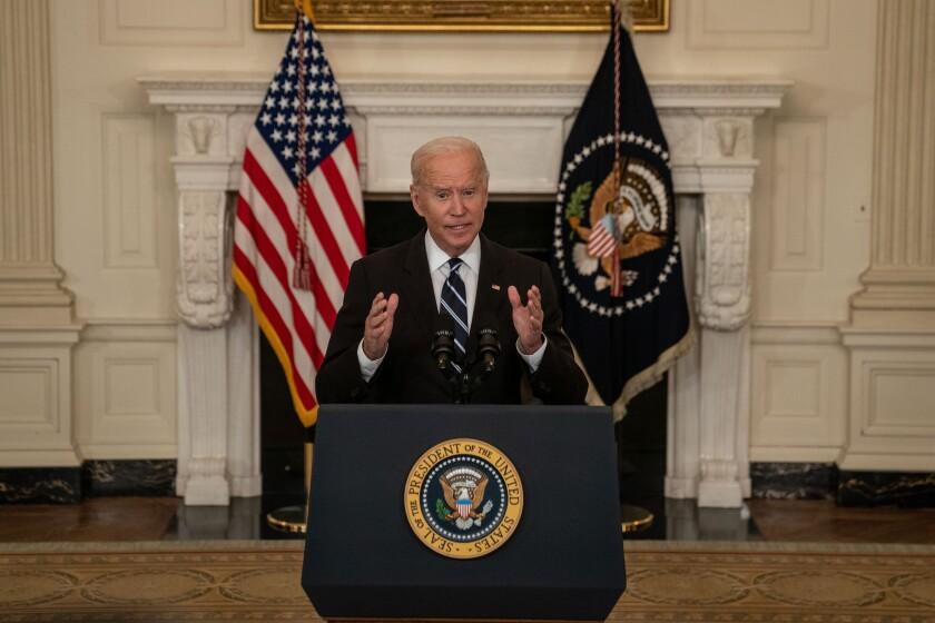 President Biden speaks at a lectern in the White House