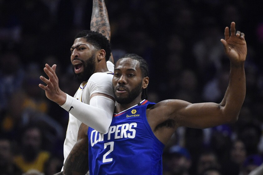 The Lakers' Anthony Davis and Clippers' Kawhi Leonard battle March 8, 2020.