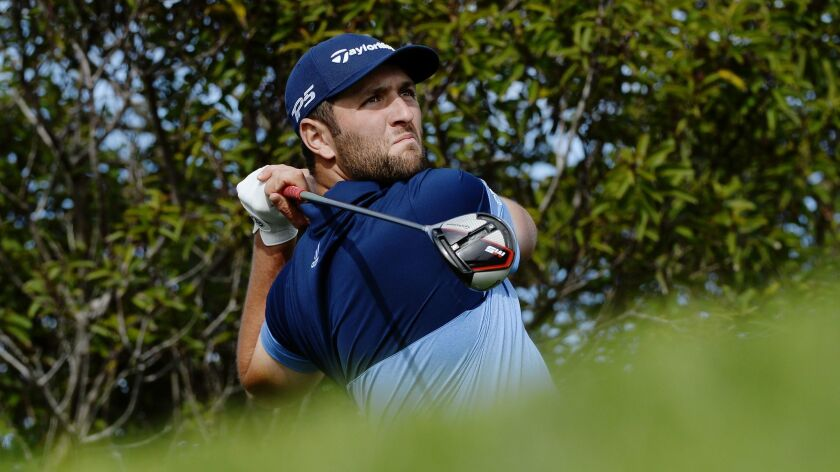 Jon Rahm hits from the seventh tee during the opening round of the Farmers Insurance Open at Torrey Pines on Thursday.