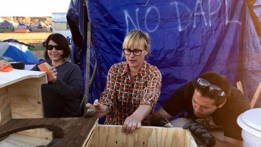 Alisa Keesey, Patricia Arquette and Steffan Thimmes of GiveLove.org built composting toilets at the Dakota Access pipeline protest