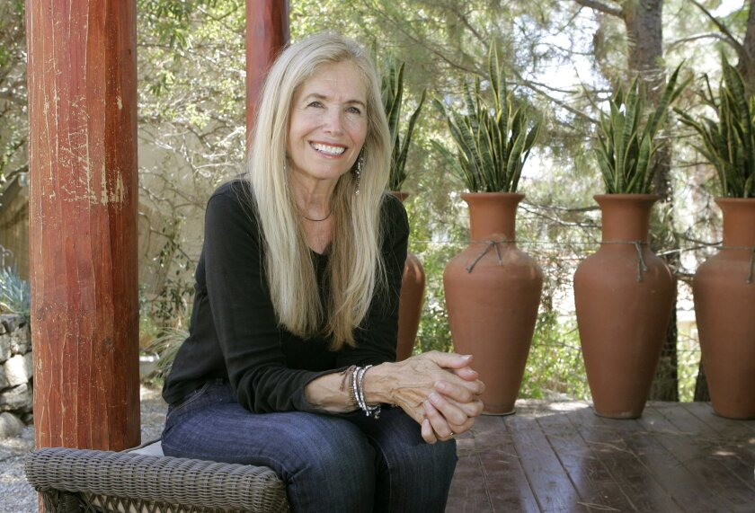 <p>  Mimi Kirk of Ramona won the title of Sexiest Vegetarian over 50. She has been a vegetarian for 40 years.  <em>   Charlie Neuman / Union-Tribune  </em> </p>