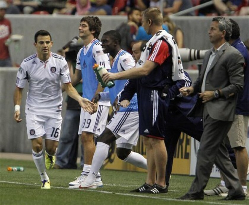 Chicago Fire midfielder Marco Pappa (16) is congratulated by teammates after scoring a goal against Real Salt Lake during the first half of an MLS soccer match in Salt Lake City, Wednesday, Sept. 28, 2011. (AP Photo/Jim Urquhart)