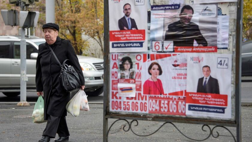 Election posters hang in Yerevan, Armenia, before the Dec. 9 early parliamentary vote.