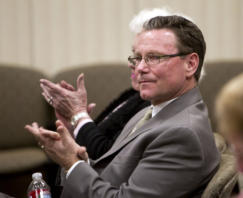 Shawn Nelson sits in the audience at the Menifee City Councill meeting on Tuesday.
