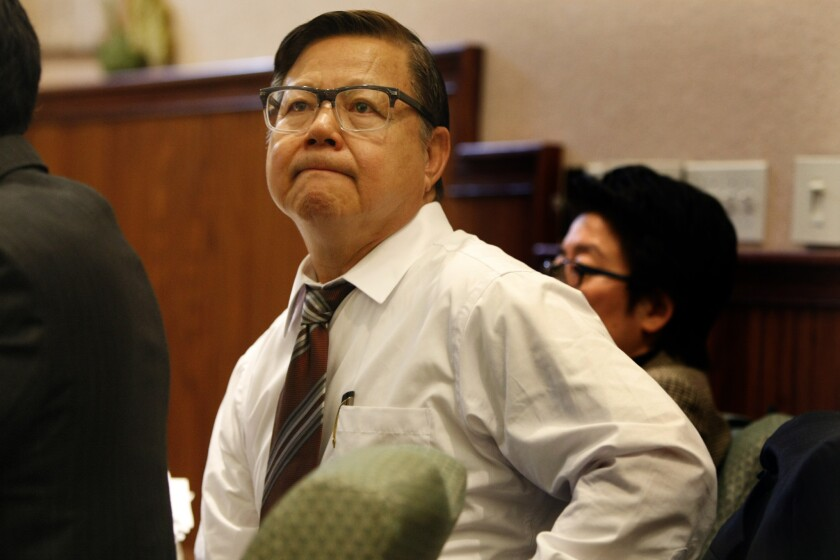 San Gabriel Councilman-elect Chin Ho Liao listens to attorney arguments during an administrative hearing to determine if he is qualified to sit on the council.