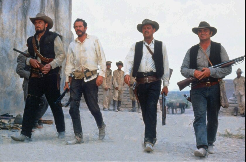 """A still from Warner Bros.' restored release of director Sam Peckinpah's classic western, """"The Wild Bunch,"""" featuring Ben Johnson as Tector Gorch, left, Warren Oates as Lyle Gorch, William Holden as Pike Bishop and Ernest Borgnine as Dutch Engstrom."""