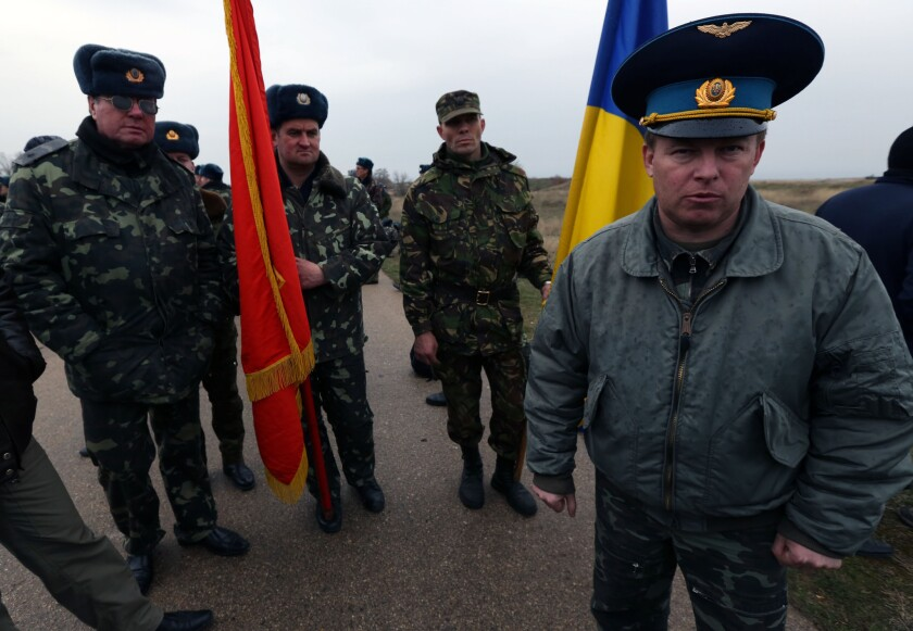 Col. Yuly Mamchur, right, commander of a Ukraine army unit guarding a military airport in Belbek on the Crimean peninsula, is shown at the base last week. On Thursday, he threatened to have his forces open fire on Russian troops holding part of the base.