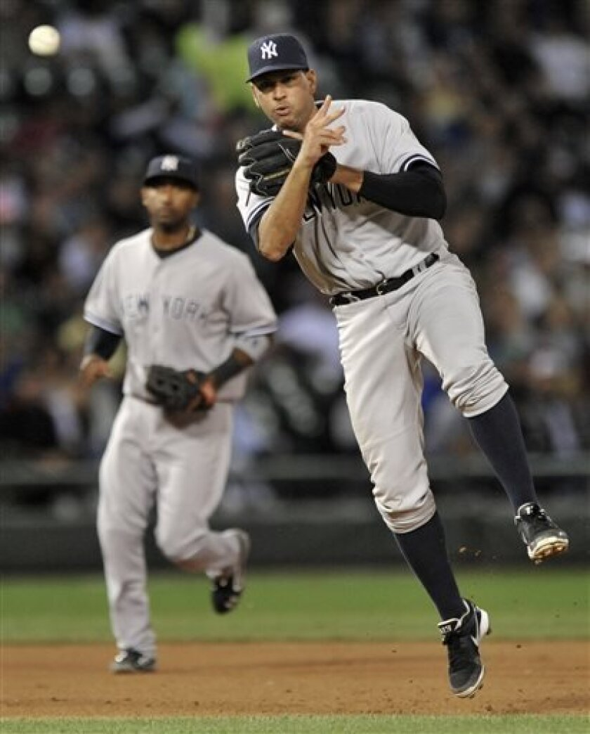 New York Yankees third baseman Alex Rodriguez, right, throws to first base during the sixth inning of a baseball game against the Chicago White Sox in Chicago, Monday, Aug. 5, 2013. (AP Photo/Paul Beaty)
