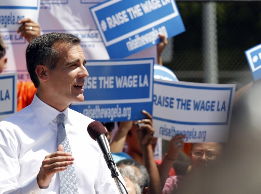 Mayor Eric Garcetti is seen last month announcing his plan to raise the minimum wage in Los Angeles to more than $13 an hour.