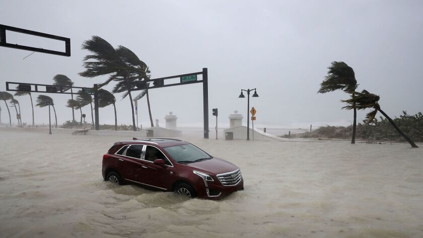 A car sits abandoned in storm surge along North Fort Lauderdale Beach Boulevard as Hurricane Irma hits the southern part of Florida in Fort Lauderdale.