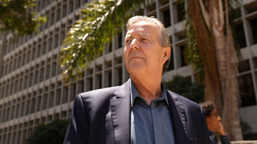 Palmdale Mayor Jim Ledford leaves court in Los Angeles after a hearing last year in his corruption case. Prosecutors filed an additional misdemeanor count against him Wednesday.