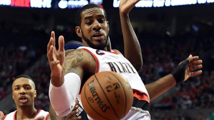 Portland Trail Blazers center LaMarcus Aldridge battles for a rebound during a playoff game against the Memphis Grizzlies on April 27.