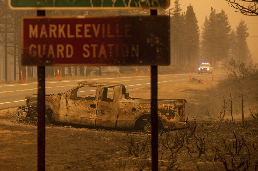 A charred pickup left by the Tamarack fire in Markleeville, Alpine County, in July