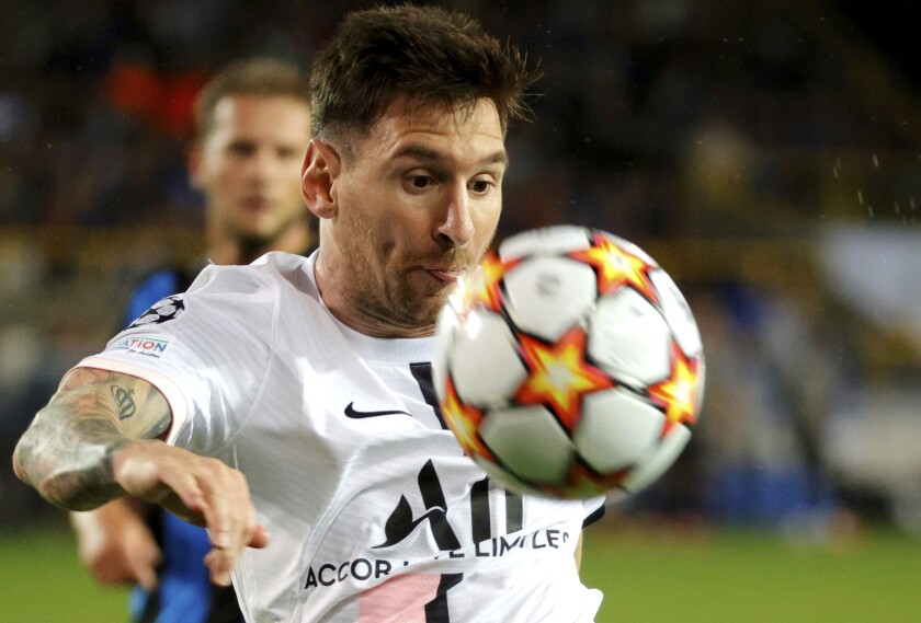 PSG's Lionel Messi fights for control of the ball during the Champions League Group A s
