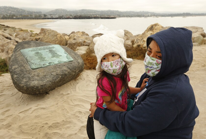 A woman and a child wearing face masks