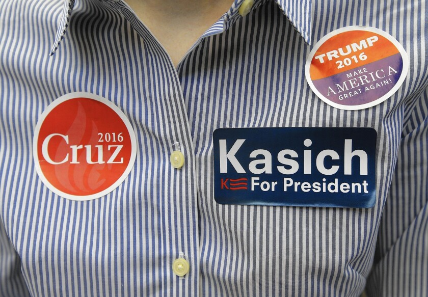 At least one attendee appeared noncommittal at the California GOP convention in Burlingame, wearing stickers for all three remaining Republican presidential candidates.