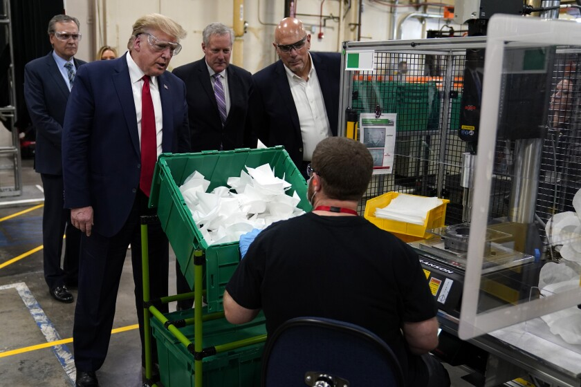 President Trump takes a tour on Tuesday of a Honeywell International plant in Phoenix that manufactures personal protective equipment.