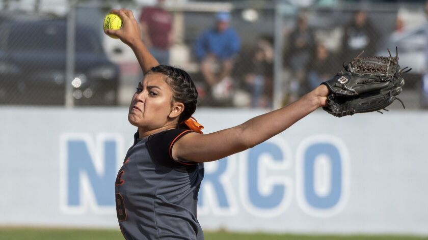 Huntington Beach's Grace Uribe pitches during a CIF Southern Section Division 1 quarterfinal playoff game against Norco on May 24, 2018.