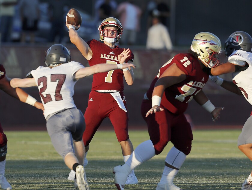 Alemany quarterback Miller Moss throws downfield against against Jordan High School (Utah)  in the first quarter on Friday.