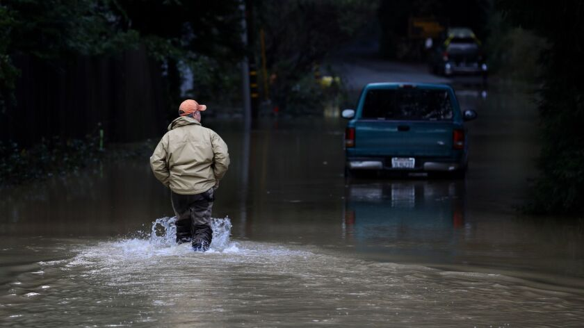 A storm brought flooding Feb. 15 to Guerneville, Calif. Another storm is expected to unleash rain and snow in Northern California this week.